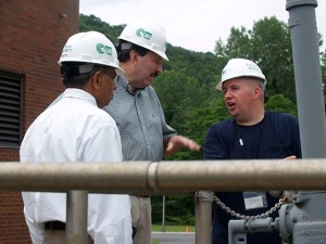Legislator Testa speaking with the plant supervisor and county engineer while touring the Peekskill plant.